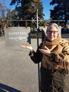 Photo of Linnea in front of Cafeteria sign